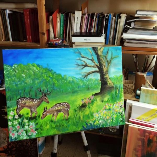 two grazing deer